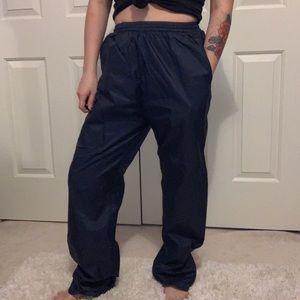 Navy blue windbreaker track pants